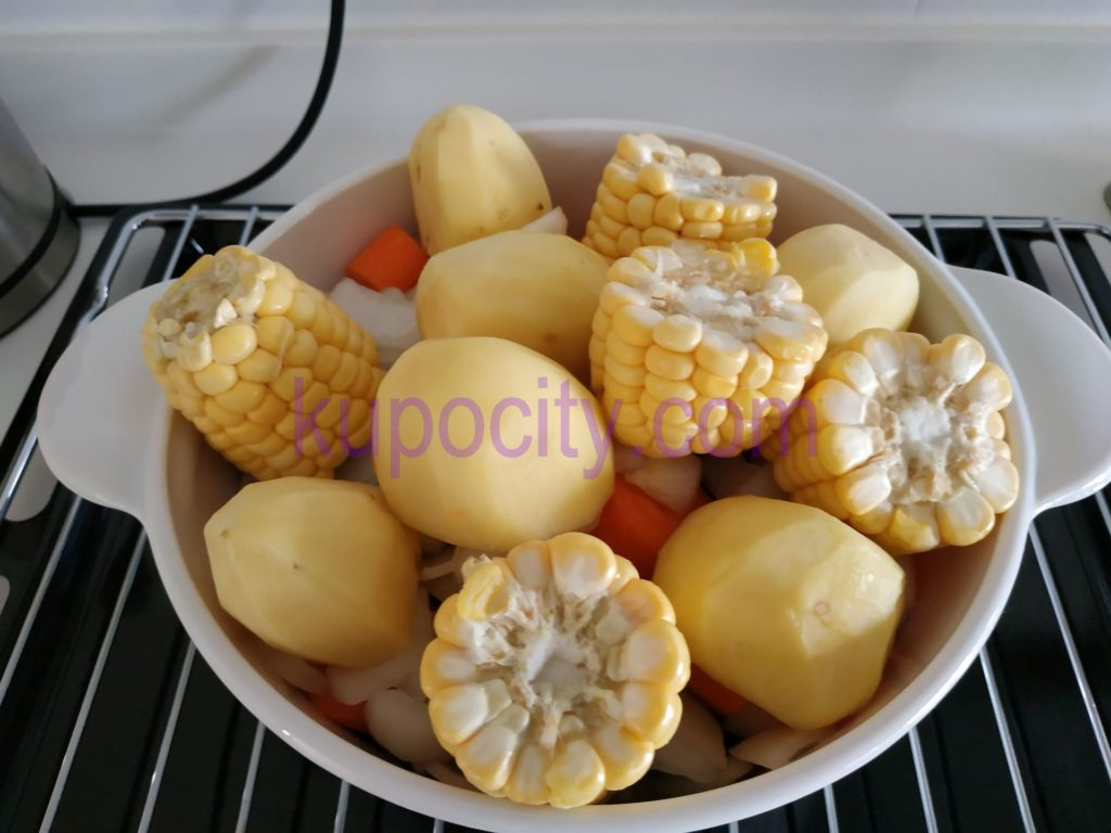 Place corn and potato on top.