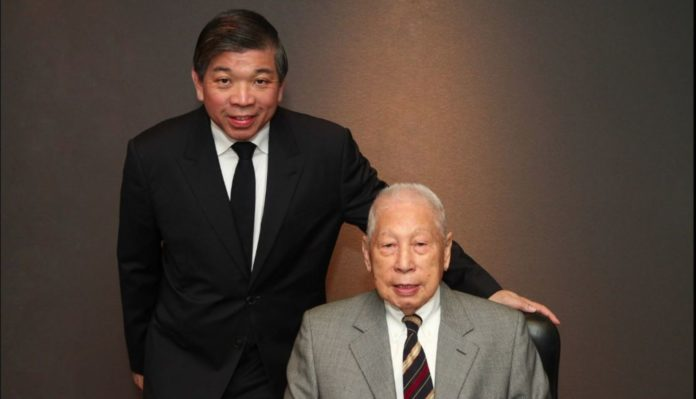 Chang Yun Chung (right), founder of Pacific International Lines (PIL), with his son Teo Siong Seng (left)