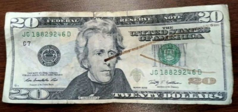 Twenty dollar bill with counterfeit detecting ink