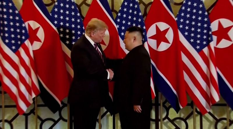 The two leaders posed in front of flags as the press was taking photos of them shake their hands together.
