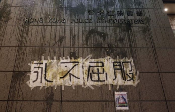 Hong Kong police headquarters surrounded by protesters over unmet demands